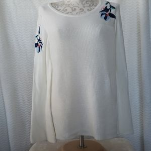 White sweater with embroidered applique